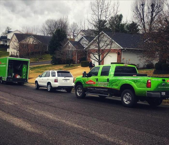 Green SERVPRO Vehicles in a subdivison in Washington, MO