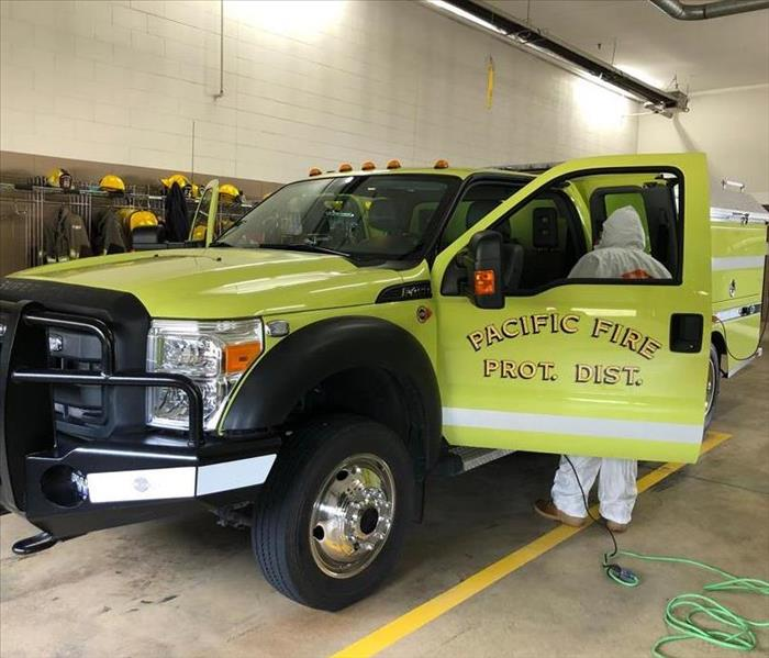 SERVPRO Technician disinfecting a Pacific, MO fire truck.