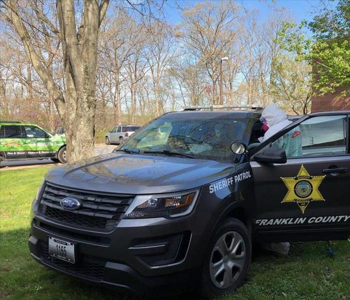 SERVPRO technician disinfecting Franklin County Sheriff's Office Vehicles