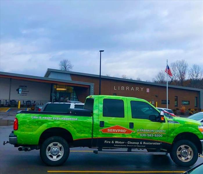 Green SERVPRO Ford truck in front of the Scenic Regional Library in Union, MO