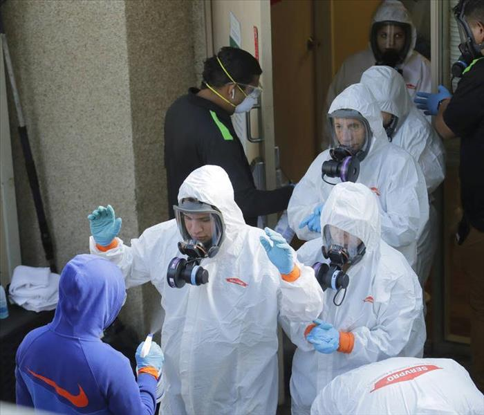 SERVPRO Disaster Recovery Team in Biohazard Suits