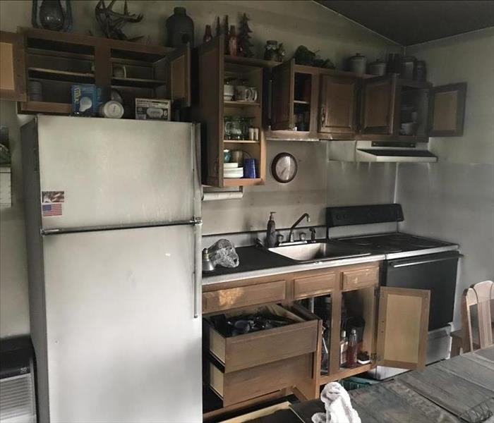 Kitchen with fire and smoke damage