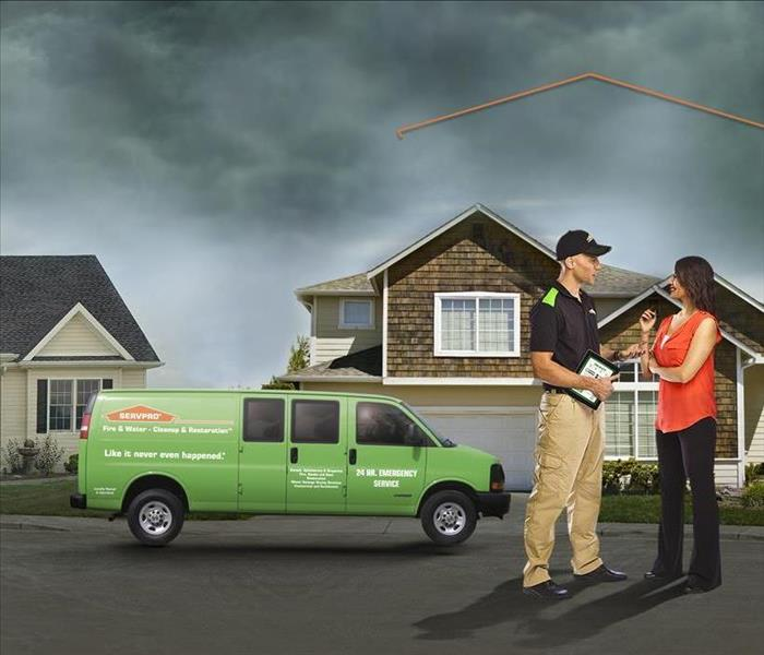 SERVPRO technican and customer in front of customers home.