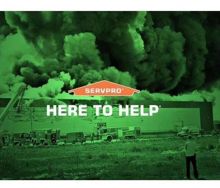 "Image of fire damaged building with text ""Here to Help"""